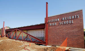 Photo - Steel is put in place at the entrance during construction on Western Heights High School. The building is undergoing a makeover.