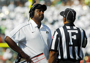 Photo -   FILE - In this Saturday, Sept. 1, 2012, file photo, Colorado head coach Jon Embree, left, reacts to a call against his team after conferring with field judge Michael Mothershed as during the third quarter of an NCAA college football game against Colorado State in Denver. Embree is facing a chorus of jeers from fans after the Golden Buffaloes lost the opening three games of their 2012 season. (AP Photo/David Zalubowski, File)