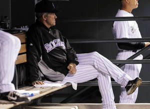 Photo -   Colorado Rockies manager Jim Tracy looks on as his team falls behind to the Arizona Diamondbacks in the sixth inning of a baseball game in Denver on Saturday, Sept. 22, 2012. The Diamondbacks won 8-7. (AP Photo/David Zalubowski)