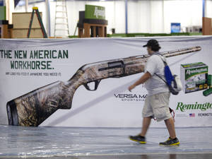 Photo - Exhibitors began setting up in preparation The National Rifle Association Annual Meetings on Wednesday, May 1, 2013, in Houston.  The 2013 NRA Annual Meetings and Exhibits is scheduled to being Friday. (AP Photo/Houston Chronicle, Johnny Hanson)