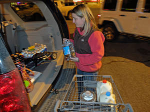 Photo - Laura John of Charleston, W.Va, drove across town to South Charleston, W.Va, to find water following a chemical spill on the Elk River that compromised the public water supply of eight counties of Thursday, Jan. 9, 2014. (AP Photo/Tyler Evert)