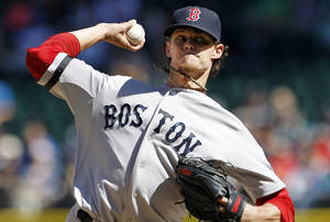 Photo -   Boston Red Sox starting pitcher Clay Buchholz throws against the Seattle Mariners in the third inning of a baseball game, Monday, Sept. 3, 2012, in Seattle. (AP Photo/Elaine Thompson)