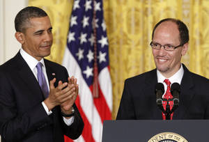 photo - President Barack Obama applauds in the East Room of the White House in Washington, Monday March 18, 2013, where he announced he would nominate Thomas E. Perez, right, for Labor Secretary.  (AP Photo/Jacquelyn Martin)