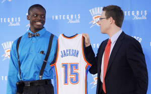 photo - Oklahoma City Thunder draft pick Reggie Jackson, left, and Sam Presti, general manager of the Thunder, hold up Jackson's jersey as he is introduced during a new conference at the Boys and Girls Club of Oklahoma County in Oklahoma City, Saturday, June 25, 2011. The Thunder selected Reggie Jackson with the 24th pick in this year's NBA draft. Photo by Nate Billings, The Oklahoman