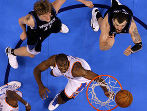 photo - Oklahoma City's Serge Ibaka (9) watches the ball after a shot in front of Minnesota's Andrei Kirilenko (47) and Nikola Pekovic (14) during an NBA basketball game between the Oklahoma City Thunder and the Minnesota Timberwolves at Chesapeake Energy Arena in Oklahoma City, Wednesday, Jan. 9, 2013.  Oklahoma City won 106-84. Photo by Bryan Terry, The Oklahoman