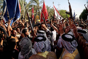 Photo - Shiite tribal fighters raise their weapons and chant slogans Monday in Basra, Iraq, to protest against the Sunni insurgent force of the Islamic State of Iraq and Syria.  AP photo <strong>Nabil Al-Jurani</strong>