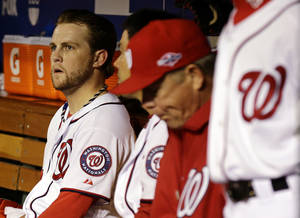 Photo -   Washington Nationals relief pitcher Drew Storen, left, looks on from the dugout after Game 5 of the National League division baseball series against the St. Louis Cardinals on Saturday, Oct 13, 2012, in Washington. St. Louis won 9-7. (AP Photo/Alex Brandon)