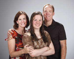 Photo - HIGH SCHOOL SWIMMING / DAWN HILDEBRAND: All-City Swimmer Jessi Hildebrand with her parents, Dawn and Devin Hildebrand at OPUBCO studio Tuesday April 3, 2012. Photo by Doug Hoke, The Oklahoman