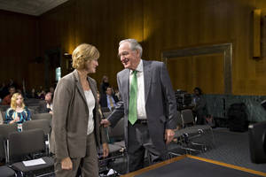 Photo - Senate Health, Education, Labor, and Pensions Committee Chairman Sen. Tom Harkin, D-Iowa greets Medicare chief Marilyn Tavenner on Capitol Hill in Washington, Tuesday, Nov. 5, 2013, prior to he testifying before the committee's hearing on problems with the debut of the Affordable Care Act. (AP Photo/J. Scott Applewhite)