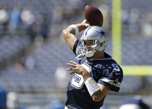 Photo - Dallas Cowboys quarterback Tony Romo warms up before an NFL football game against the San Diego Chargers Sunday, Sept. 29, 2013, in San Diego. (AP Photo/Gregory Bull)