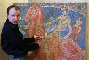 Photo - In this photo taken Friday, Feb. 8, 2013, Belarusian artist Igor Arinich shows an image made of hundreds of Soviet-era banknotes in Minsk, Belarus. Arinich has used Soviet banknotes which he buys at local flea markets in Belarus for his works. (AP Photo/Sergei Grits)