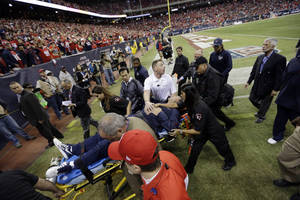 Photo - Houston Texans head coach Gary Kubiak is taken off the field on a stretcher during the second quarter of an NFL football game against the Indianapolis Colts, Sunday, Nov. 3, 2013, in Houston. (AP Photo/David J. Phillip)