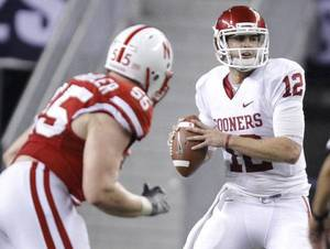 photo - Oklahoma's Landry Jones (12) looks to pass the ball during the Big 12 football championship game between the University of Oklahoma Sooners (OU) and the University of Nebraska Cornhuskers (NU) at Cowboys Stadium on Saturday, Dec. 4, 2010, in Arlington, Texas. Photo by Chris Landsberger, The Oklahoman <strong>CHRIS LANDSBERGER</strong>