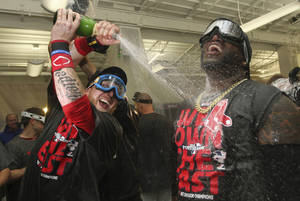 Photo - Boston Red Sox designated hitter David Ortiz, right, and teammate Mike Carp celebrate after the Red Sox clinched the AL East with a 6-3 win over the Toronto Blue Jays in a baseball game at Fenway Park, Friday, Sept. 20, 2013, in Boston. (AP Photo/Charles Krupa)