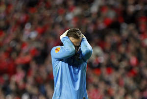 Photo - PAOK's goalkeeper Panagiotis Glykos reacts during the Europa League round of 32 second leg soccer match between Benfica and PAOK at Benfica's Luz stadium in Lisbon, Thursday, Feb. 27, 2014. Benfica won 3-0. (AP Photo/Francisco Seco)