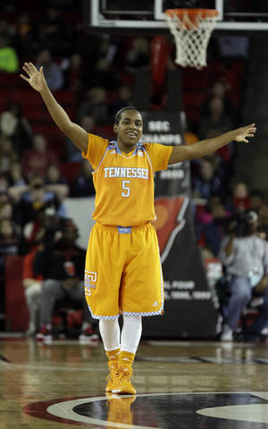 Photo - Tennessee guard Ariel Massengale (5) reacts in the closing moments of the second half of an NCAA college basketball game against Georgia, Sunday, Jan. 5, 2014, in Athens, Ga. Tennessee won 85-70. (AP Photo/John Bazemore)