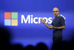 Photo - FILE - In this April 2, 2014 file photo, Microsoft CEO Satya Nadella gestures during the keynote address of the Build Conference in San Francisco. Microsoft reports quarterly earnings on Thursday, April 24, 2014. (AP Photo/Eric Risberg, File)