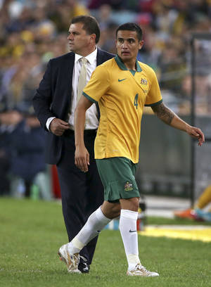 Photo - Australia's Tim Cahill, right, is substituted by coach Ange Postecoglou during their friendly soccer match in Sydney, Monday, May 26, 2014. The game is a 1-1 draw. (AP Photo/Rick Rycroft)