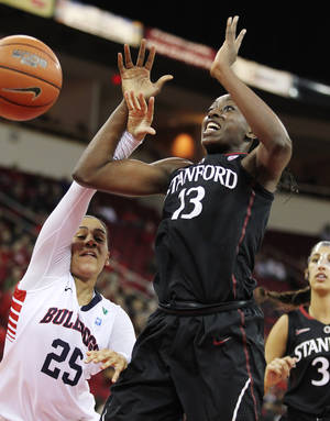 Photo - Stanford's Chiney Ogwumike grabs a rebound from Fresno State's Moriah Faulk in the first half of an NCAA women's college basketball game, Saturday, Dec. 28, 2013, in Fresno, Calif. (AP Photo/Gary Kazanjian)