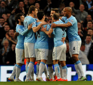 Photo - Manchester City players celebrate after Sergio Aguero scored against West Bromich Albion during their English Premier League soccer match at the Etihad Stadium,  Manchester, England, Monday April 21, 2014. (AP Photo/Rui Vieira)