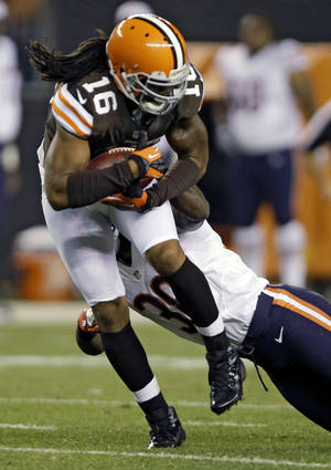 Photo -   Cleveland Browns wide receiver Josh Cribbs (16) catches a pass against Chicago Bears running back Lorenzo Booker in the second quarter of a preseason NFL football game Thursday, Aug. 30, 2012, in Cleveland. (AP Photo/Mark Duncan)