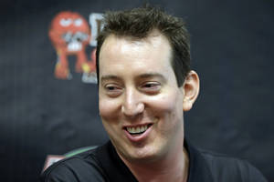 photo - Kyle Busch answers a question from the media during a news conference at Joe Gibbs Racing in Huntersville, N.C., Thursday, Jan. 24, 2013, as part of the NASCAR Sprint Cup Media Tour. (AP Photo/Chuck Burton)
