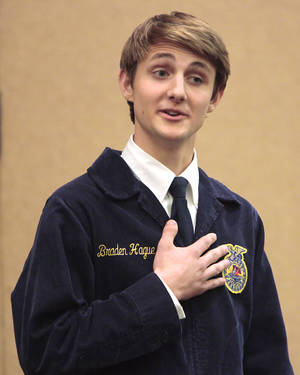 Photo - Braden Hague of Edmond competes in the public speaking competition during the state FFA convention at Cox Convention Center. Photo by David McDaniel, The Oklahoman <strong>David McDaniel - The Oklahoman</strong>