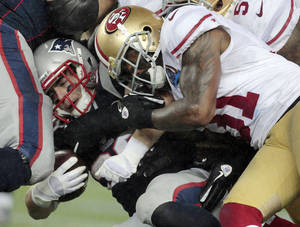 Photo - San Francisco 49ers strong safety Donte Whitner (31) tackles New England Patriots running back Danny Woodhead (39) in the third quarter of an NFL football game in Foxborough, Mass., Sunday, Dec. 16, 2012. (AP Photo/Steven Senne)