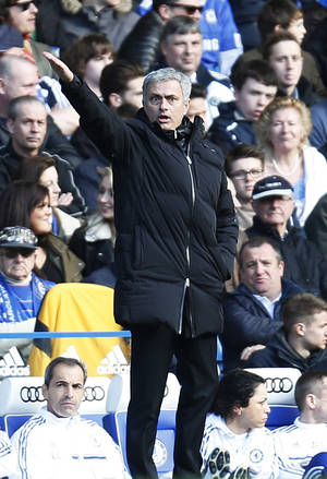 Photo - Chelsea's manager Jose Mourinho gives instructions to his players during an English Premier League soccer match against Everton at the Stamford Bridge ground in London, Saturday, Feb. 22, 2014. Chelsea won the match 1-0. (AP Photo/Lefteris Pitarakis)