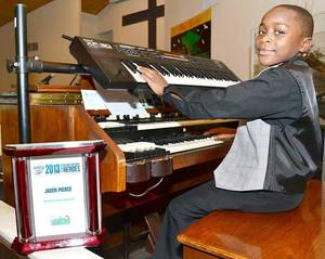 "photo - From <a href=""http://www.swoknews.com/news-top/local/item/5273-organist-inspires-lawton-youngster-earns-him-jersey"">The Lawton Constitution</a>"