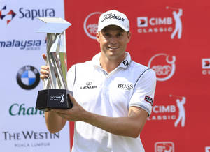 Photo -   Nick Watney of the United States poses with his trophy after the final of CIMB Classic golf tournament at the Mines Resort and Golf Club in Kuala Lumpur, Malaysia, Sunday, Oct. 28, 2012. (AP Photo/Peter Lim)