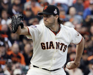 photo -   San Francisco Giants starting pitcher Barry Zito throws during the first inning of Game 1 of baseball's World Series against the Detroit Tigers Wednesday, Oct. 24, 2012, in San Francisco. (AP Photo/David J. Phillip)