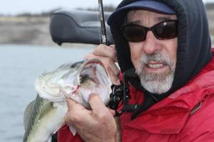 photo - Just because it's cold doesn't mean you can't catch bass. Former Bassmaster Classic champion Ken Cook of Meers recommends fishing more slowly and using lighter tackle for winter bites. PHOTO PROVIDED