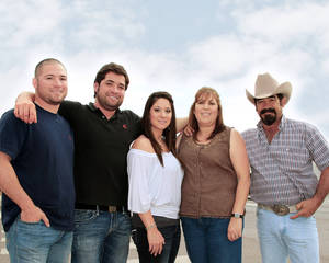 photo - Frankie and Connie Marquez were among the first Mexican-Americans to start a family in Hennessey. From left: Eric, Randy, Betsy, Connie and Frankie. (Photo by Warren Vieth, Oklahoma Watch) <strong>Warren Vieth</strong>