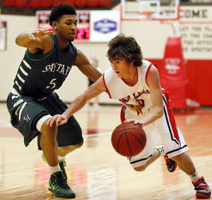 Photo - Yukon's Tanner Akers (5), right, drives against Edmond Santa Fe's Josiah Hunter (5) during a boys high school basketball game between Edmond Santa Fe and Yukon at Yukon High School in Yukon, Okla., Friday, Jan. 31, 2014. Photo by Nate Billings, The Oklahoman