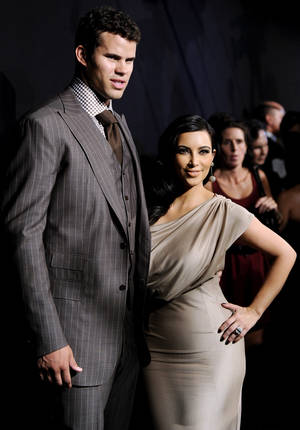 Photo -   FILE - In this Aug. 31, 2011 file photo, newlyweds Kim Kardashian and Kris Humphries attend a party thrown in their honor at Capitale in New York. Kardashian's divorce attorney told a judge Friday, May 4, 2012, that she believes Humphries' hurt feelings about the marriage are slowing down the case and that it could get very expensive for the NBA player if he continues to pursue his claims the couple's nuptials were a fraud. Humphries filed for an annulment of the couple's 72-day marriage on Thursday in Los Angeles. (AP Photo/Evan Agostini, file)
