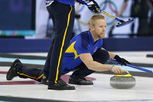 Photo - Sweden skip Niklas Edin delivers the stone during men's curling training at the 2014 Winter Olympics, Saturday, Feb. 8, 2014, in Sochi, Russia. (AP Photo/Robert F. Bukaty)