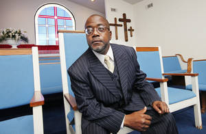 Photo - Pastor James Dorn, president of the Progressive National Baptist Convention, in the sanctuary of his church, Mt. Triumph Baptist Church, in Oklahoma City Tuesday, April 30, 2013.  Photo by Paul B. Southerland, The Oklahoman