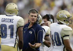 photo -   FILE - In this Sept. 15, 2012, file photo, Georgia Tech head coach Paul Johnson talks to players during an NCAA college football game against in Atlanta. Georgia Tech must recover from two straight home losses, including a humiliating 49-28 loss to Middle Tennessee State. The challenge grows more difficult with Saturday's visit to No. 15 Clemson. (AP Photo/David Goldman, File)