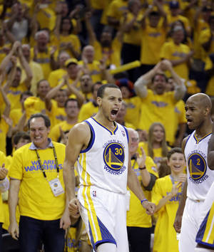 Photo - Golden State Warriors' Stephen Curry (30) reacts after scoring against the Denver Nuggets during the second half of Game 4 in a first-round NBA basketball playoff series on Sunday, April 28, 2013, in Oakland, Calif. (AP Photo/Ben Margot)