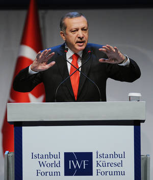Photo -   Turkey's Prime Minister Recep Tayyip Erdogan addresses a forum in Istanbul, Turkey, Saturday, Oct. 13, 2012. Turkey's prime minister sharply criticized the U.N. Security Council on Saturday for its failure to agree on decisive steps to end the 19-month civil war in Syria. (AP Photo)