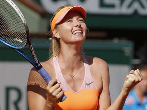 Photo - Russia's Maria Sharapova reacts as she defeats Canada's Eugenie Bouchard during their semifinal match of  the French Open tennis tournament at the Roland Garros stadium, in Paris, France, Thursday, June 5, 2014. Sharapova won 4-6, 4-5, 6-2. (AP Photo/Michel Euler)