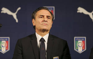 Photo - Italy coach Cesare Prandelli listens to reporters' questions during a press conference for the presentation of the new Italy soccer team jersey, in Milan, Italy, Monday, March 3, 2014.  Mario Balotelli is out injured and Daniele De Rossi has been dropped due to a code of ethics violation for Italy's friendly at World Cup holder Spain on Wednesday. Missing two key starters, coach Cesare Prandelli gave Torino forward Ciro Immobile and Parma defender Gabriel Paletta their first call ups to Italy's squad on Sunday. (AP Photo/Antonio Calanni)