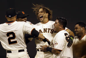 Photo - San Francisco Giants' Michael Morse, center, celebrates after making the game winning single in the ninth inning of a baseball game against the New York Mets Saturday, June 7, 2014, in San Francisco. (AP Photo/Ben Margot)