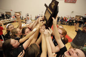 Photo - Bishop Kelley holds up their trophy after winning the OSSAA 6A State Volleyball Championship between Bishop Kelley and Edmond Memorial at Westmoore High School in Moore, Okla., Saturday, Oct. 13, 2012.  Photo by Garett Fisbeck, The Oklahoman
