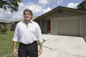 photo - In this Sept. 12, 2012, photo, Andrew Neitlich poses in front of one his investment homes in Venice, Fla. Neitlich once worked as a financial analyst picking stocks for a mutual fund. During the dot-com crash 12 years ago, Neitlich didn't sell his stocks, but like many others he is selling now.  An analysis by The Associated Press finds that individual investors have pulled at least $380 billion from U.S. stock funds since they started selling in April 2007.  (AP Photo/Chris O'Meara)