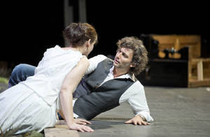 "photo - In this undated photo provided by Alla Scala theater press office, Jonas Kaufmann, right, who plays Lohengrin, and Anja Harteros, playing Elsa, perform during rehersals of Richard Wagner's Lohengrin at the Milan La Scala opera house, Italy. The dual bicentennial of the births of composers Giuseppe Verdi and Richard Wagner is turning into a dueling bicentennial. La Scala general manager Stephane Lissner on Monday, Dec. 3, 2012 dismissed as ""ridiculous"" criticism by the Italian media because the famed Milan opera house that was once Verdi's musical home is opening the celebratory season with Wagner's ""Lohengrin."" No less than Italy's respected President Giorgio Napolitano entered the fray. He wrote a letter to musical director Daniel Barenboim rejecting press rumors that he was snubbing the gala season opener on Friday. (AP Photo/Monika Rittershaus, La Scala)"