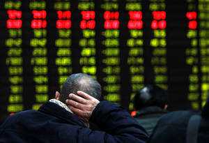 photo - In this photo released by China's Xinhua News Agency, an investor supports his head with a hand while looking at an electric stock price display at a trading hall in a securities firm in Shanghai, China, as the Shanghai Composite Index plummeted 3 percent to 2,325.95 Thursday, Feb. 21, 2013. It was the index's biggest loss in almost 15 months. World stock markets tumbled Thursday after U.S. Federal Reserve minutes gave investors an unwelcome reminder that super-easy monetary policy has an expiration date. (AP Photo/Xinhua, Ding Ding) NO SALES