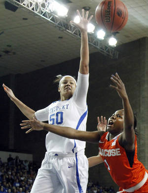 Photo - Syracuse's Alexis Peterson, right, shoots as Kentucky's Azia Bishop defends during the first half of a second-round game in the NCAA women's college basketball tournament in Lexington, Ky., Monday, March 24, 2014. (AP Photo/James Crisp)