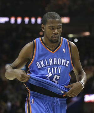 Photo - Oklahoma City Thunder's Kevin Durant walks off the court after the Cavaliers defeated the Thunder 115-110 in an NBA basketball game on Saturday, Feb. 2, 2013, in Cleveland. (AP Photo/Tony Dejak) ORG XMIT: OHTD112